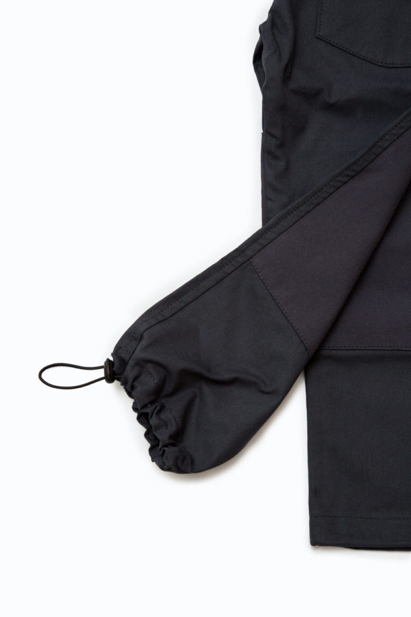 Detail showing adjustable elastic ankle of Jackalo's Jules pants in organic cotton twill
